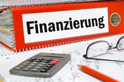 Finanzierung berechnen mit Taschenrechner und Block